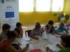 Uczestniczki spotkania wypełniaja ankiety